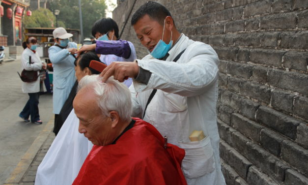 Xi'an's last remaining street barbers set up shop under the city wall
